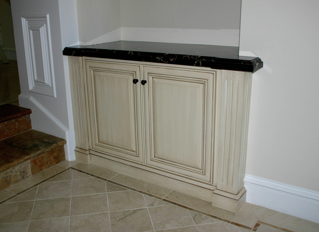 One Of Two Entry Niche Cabinets.